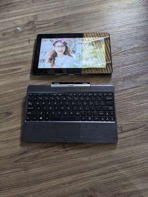 Laptop kiêm mây tính bảng asus