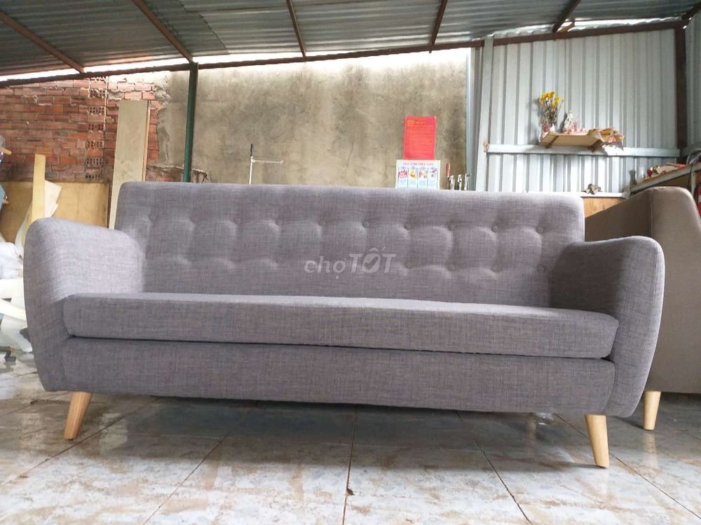 0941093348 - Ghế sofa kt1650x800 vai bố khung go dau