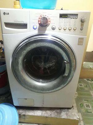 Máy giặt lồng ngang LG 12kg cửa ngang giặt êm ái.