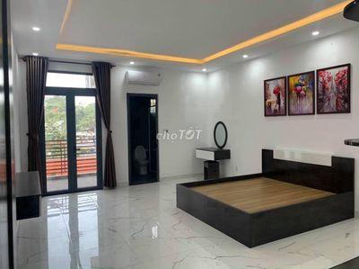Nhà đẹp 1T3L có gara oto đường Nguyễn An Ninh